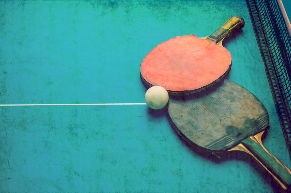 Table tennis on a grunge background