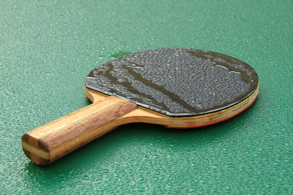 Covered with dew racket for playing ping pong on a wet table