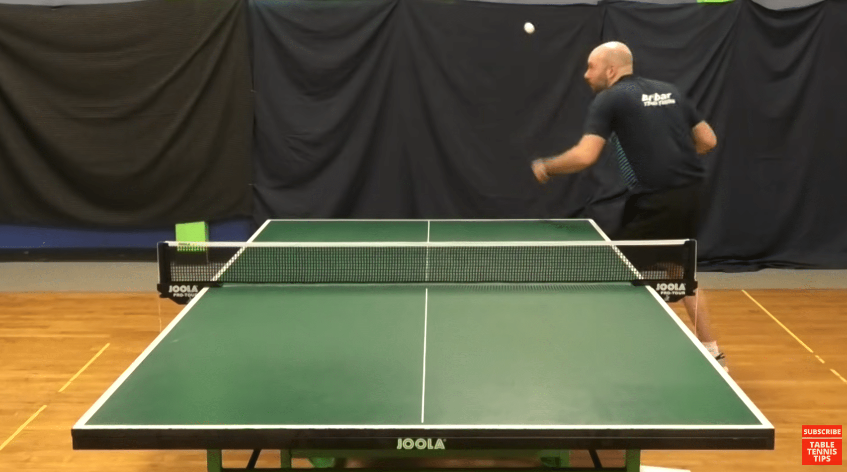 throwing serve in the air
