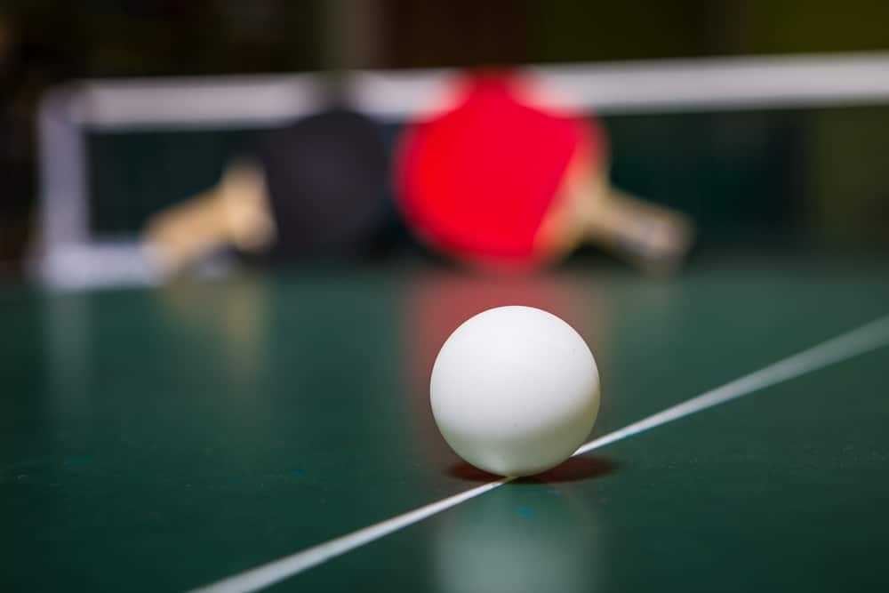 A ping pong ball on ping pong table