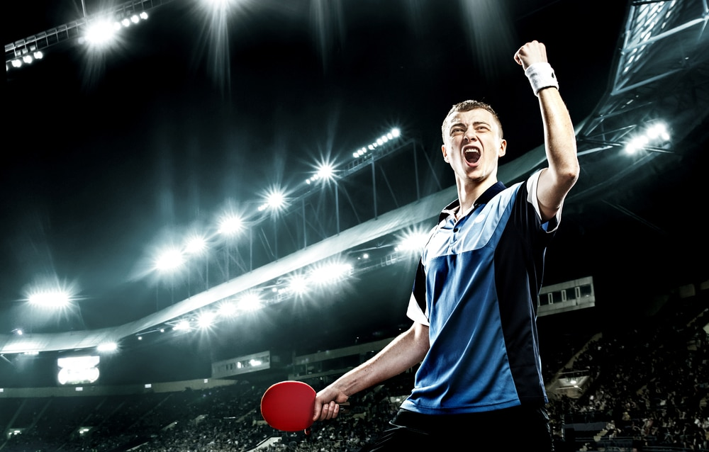 A player celebrating flawless victory in table tennis