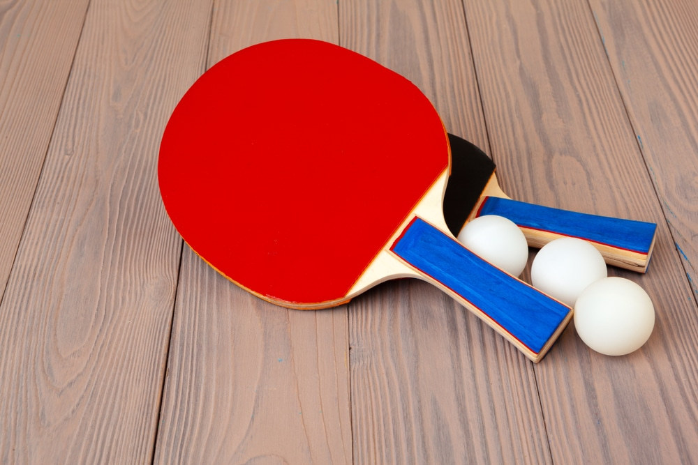 Ping pong equipment on wooden table