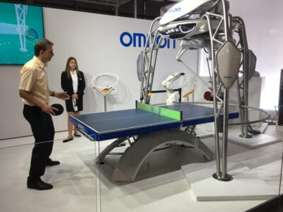Omron's table-tennis playing robot playing attendants at the Hannover Messe convention