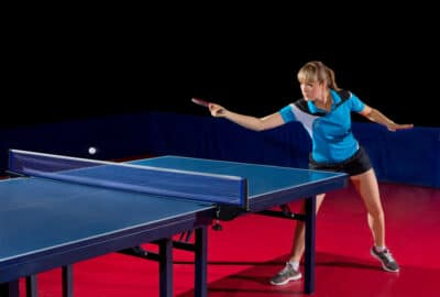 A woman playing table tennis