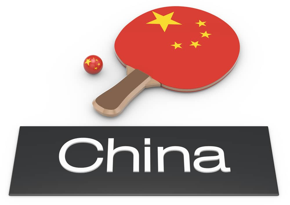 Table tennis paddle and ball with China flag