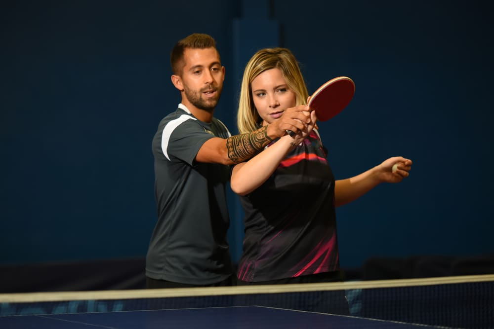 young couple practicing tennis table