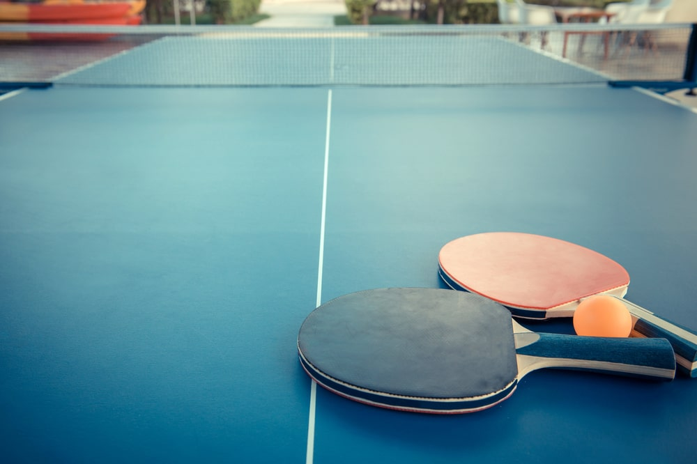 Tabletennis or ping pong rackets and balls on table