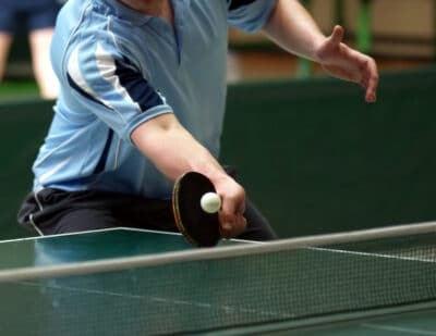 close up of a table tennis player returning a shot